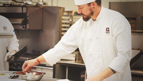 culinary student seasoning food